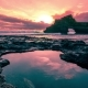 Sunset At Sea Beach Made Of Rocks With Holes Filled By Seawater In Batu Bolong Temple.   - Bali