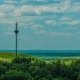 Telecommunications Tower Communications On a Background Of Sky Clouds