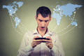 Surprised man holding smartphone connected browsing internet