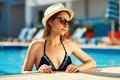 Beautiful sexy girl with healthy skin in bikini, sunglasses and