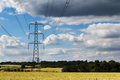 Electricity pylons going across the English countryside