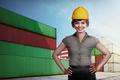 Asian business woman wearing hardhat over port background