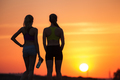 landscape with silhouette of young sporty girls at sunset