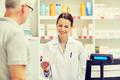 pharmacist reading prescription and senior man