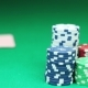Poker Player Shows His Good Pair Hand For Win And Doing Bet