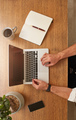 Man using a laptop on wooden table