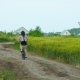 Healthy Lifestyle Woman Riding a Bike On Rural Road