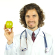 Doctor Showing Fresh Green Apple, Sign of Health