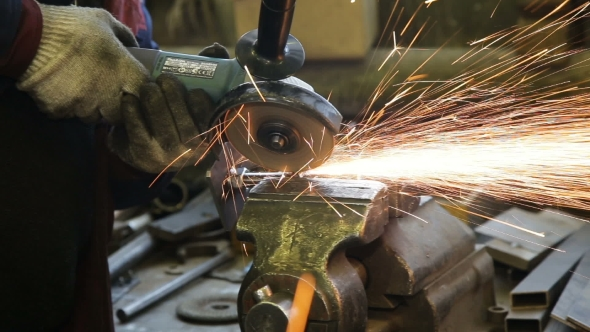 Download Worker Cutting Steel With Angle Grinder nulled download