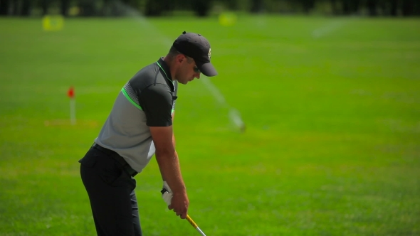 Download The Man Concentrates On The Ball During a Golf nulled download