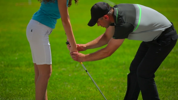 Download Man Shows Girl How To Hold a Club In Hands In Golf nulled download