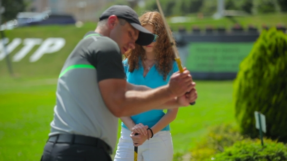 Download The Man Train The Woman To Hit The Ball In Golf nulled download