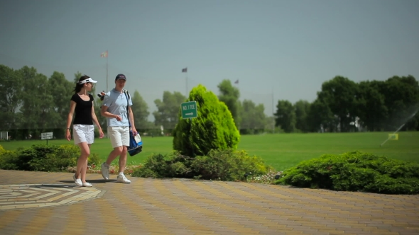 Download The Young Man And Woman Walking Near Golf Field nulled download
