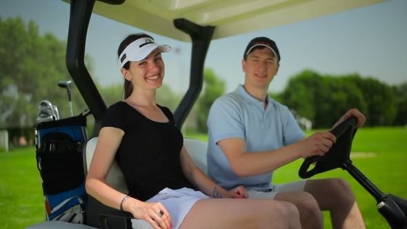 Download Young Couple Smiling in Cart at the Course nulled download