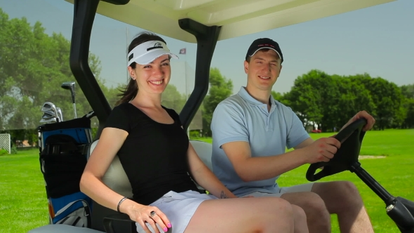 Download Couple Sitting In The Cart At The Golf Field nulled download