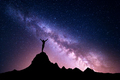 Milky Way with  silhouette of a standing sporty girl