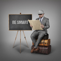 Be smart text on blackboard with explorer businessman