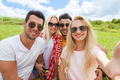 Woman hold smart phone camera taking selfie photo friends face close up picnic countryside