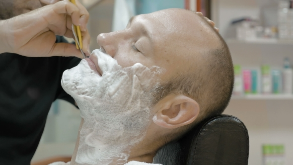 Download Barber Is Shaving His Client In Old Fashion Manner nulled download