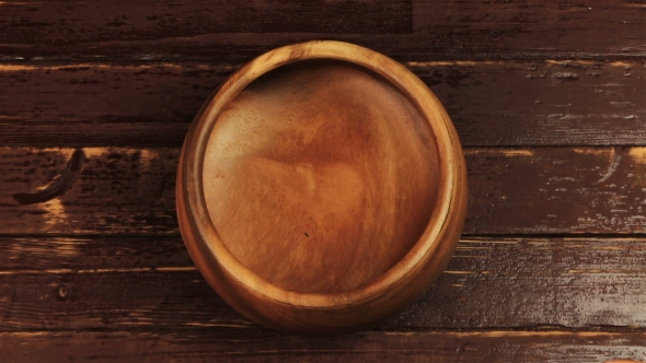 Download Male Hands Pour The Roasted Brown Coffee Beans In Wooden Plate On Brown Wooden Table nulled download