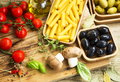 Italian pasta ingredients with mushrooms,tomatoes,olives,herbs a