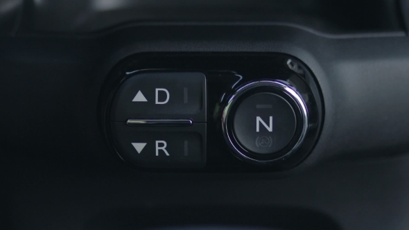Download Woman Hand Pushing Reverse Gear Button In Car nulled download
