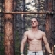 Handsome Bodybuilder Doing Pull-ups In Forest