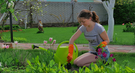 4K- Full HD-  Young girl gardening