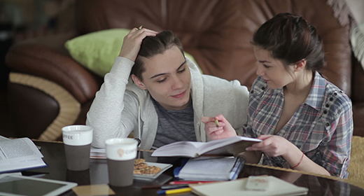 Young couple prepering for exams