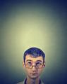 Closeup portrait pensive young man looking up