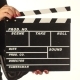Woman Uses Movie Production Clapper Board, On White
