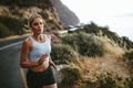 Fitness woman running outdoors in countryside