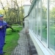 Professional Man Cleaning Dirty Windows With High Pressure Water Jet