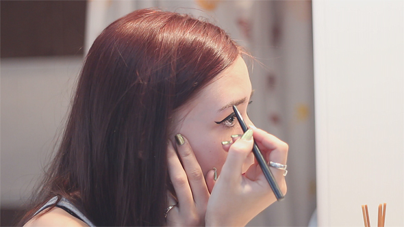 Download Woman Does Makeup on Eyebrows nulled download