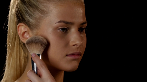 Download Make-up Artist Puts On Face Powder. Black.  nulled download