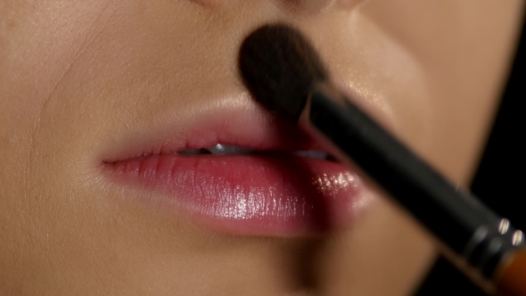 Download Applying Highlighter On The Lip Corners. Makeup.  nulled download