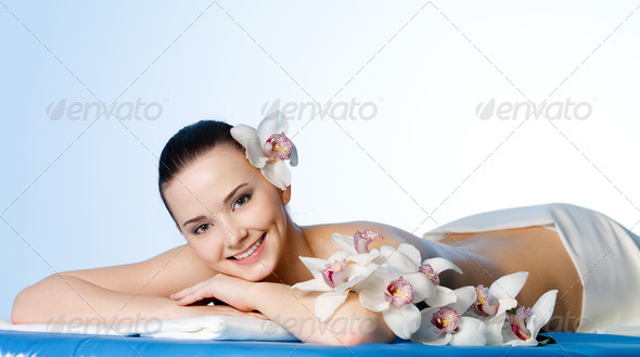 Smiling woman in beauty salon - Stock Photo - Images
