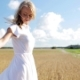 Smiling Young Woman In White Dress On Cereal Field 48