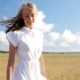 Smiling Young Woman In White Dress On Cereal Field 53