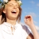 Smiling Young Woman In Wreath Of Flowers Laughing 64