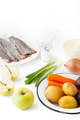 Ingredients for vegetable salad with apple and fish  on the white background vertical