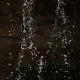 Falling Down Water On Dark Background,