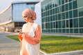 Portrait of Muslim woman wearing Hijab outdoor using mobile phone