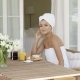 Gorgeous Woman Wrapped In Towel Sitting At Table