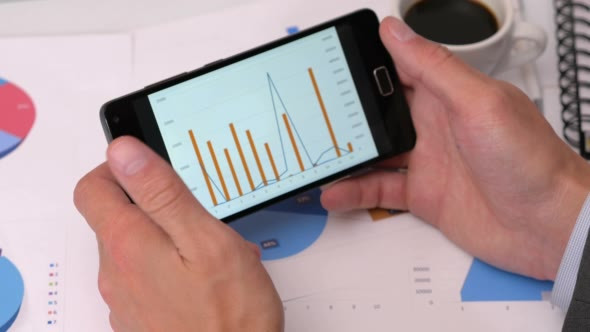 Download Looking at Diagrams on Smart Phone nulled download