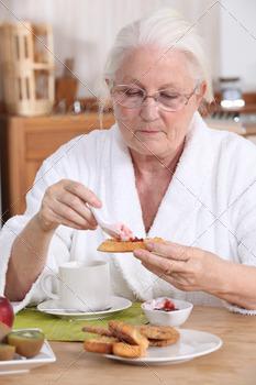 senior woman eating breakfast