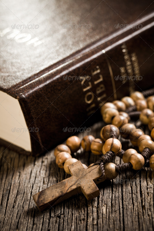wooden rosary and the Bible - Stock Photo - Images