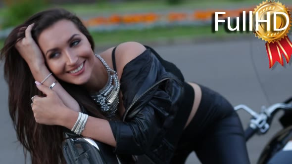 Download Beautiful Woman Biker on Her Motorcycle nulled download