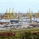 timelapse of a seaport with cranes, ships, containers and cargo in Saint-Petersburg, Russia