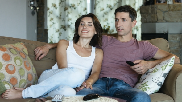 Download Married Couple Relaxing Watching Tv at Home on the Couch nulled download